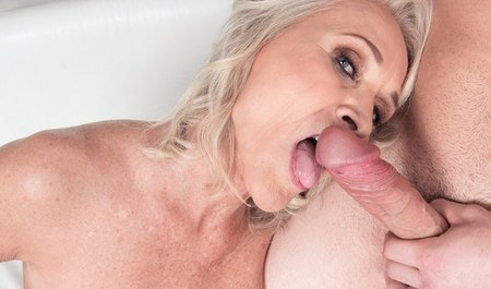 A sixty-year-old blonde with big breasts will happily rock the old days